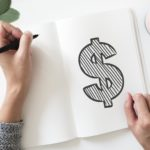 hand drawing a dollar sign