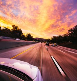Cars ahead on road in leased car