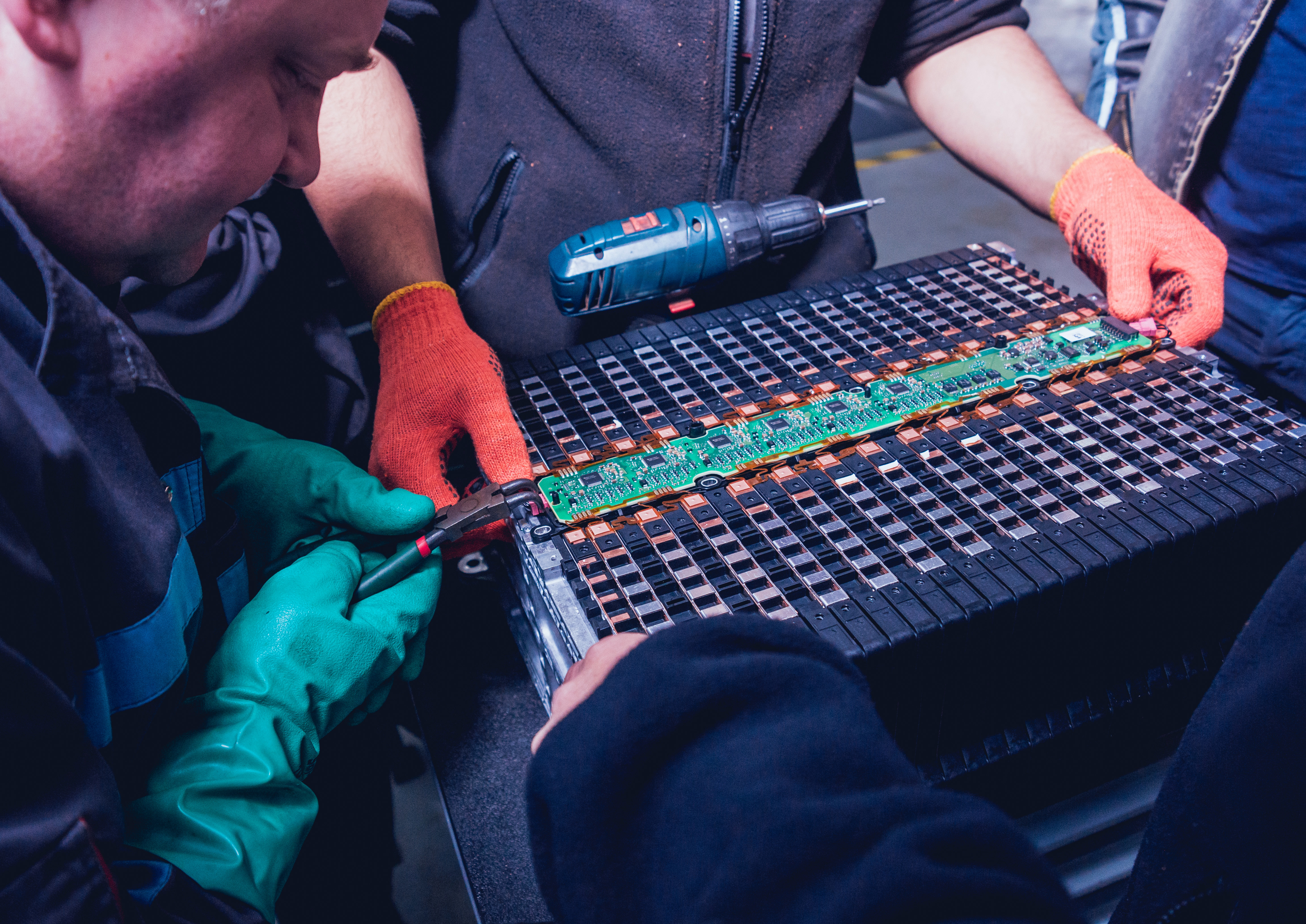 Technicians repairing car battery