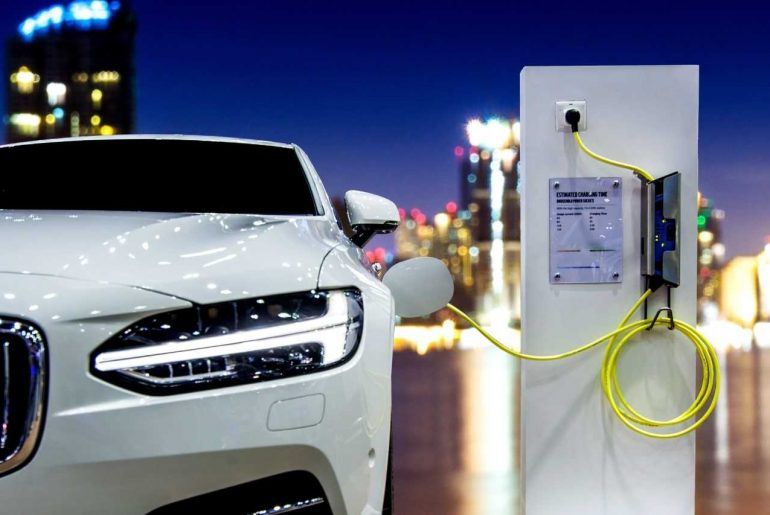 Parked car charging at night