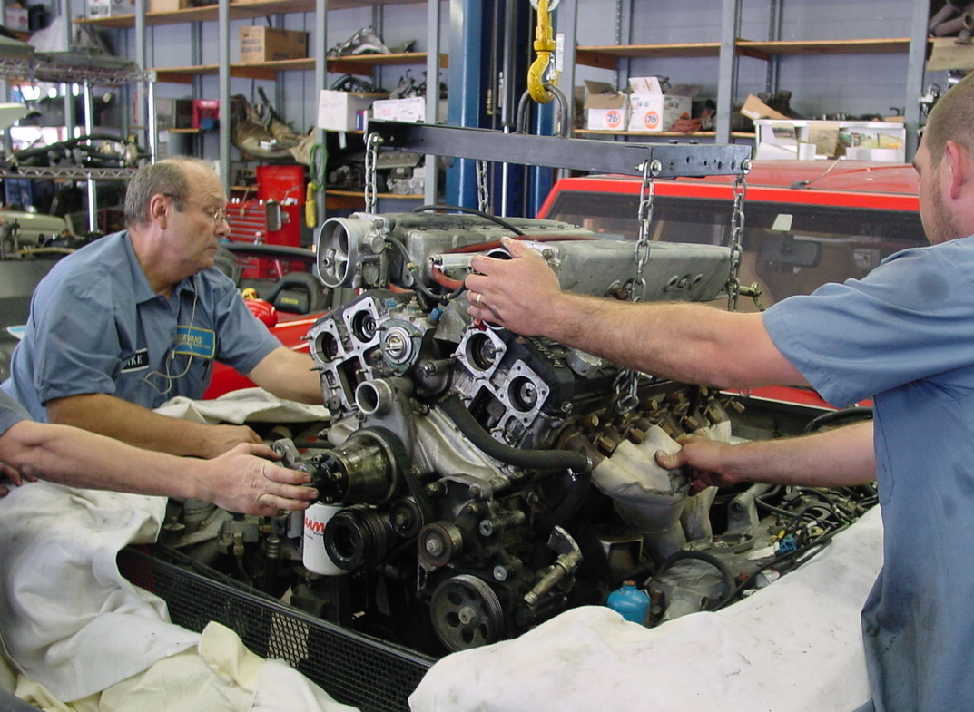 Installing an engine in a car.