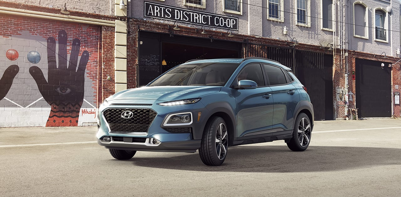 2019 Hyundai Kona Ultimate Surf Blue parked outside building