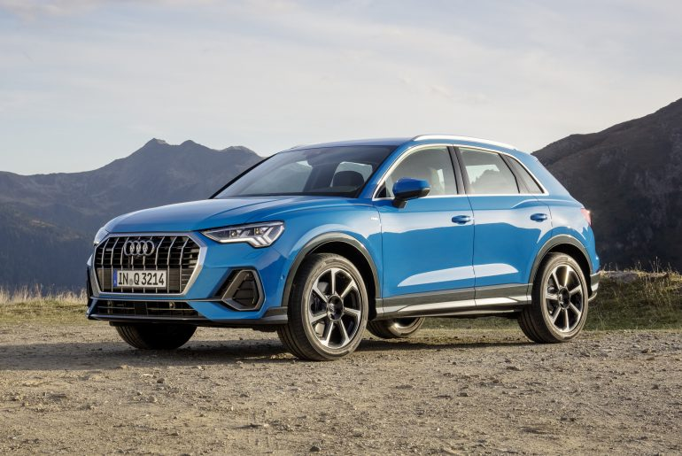 Blue 2019 Audi Q3 parked on mountain road
