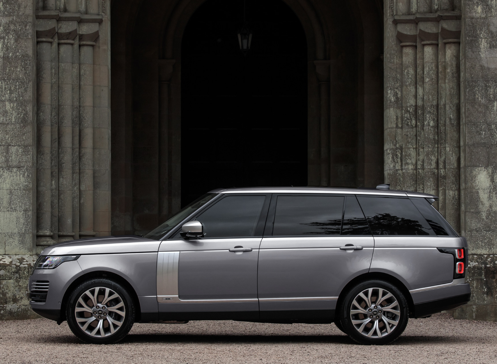 Range Rover parked outside stone building
