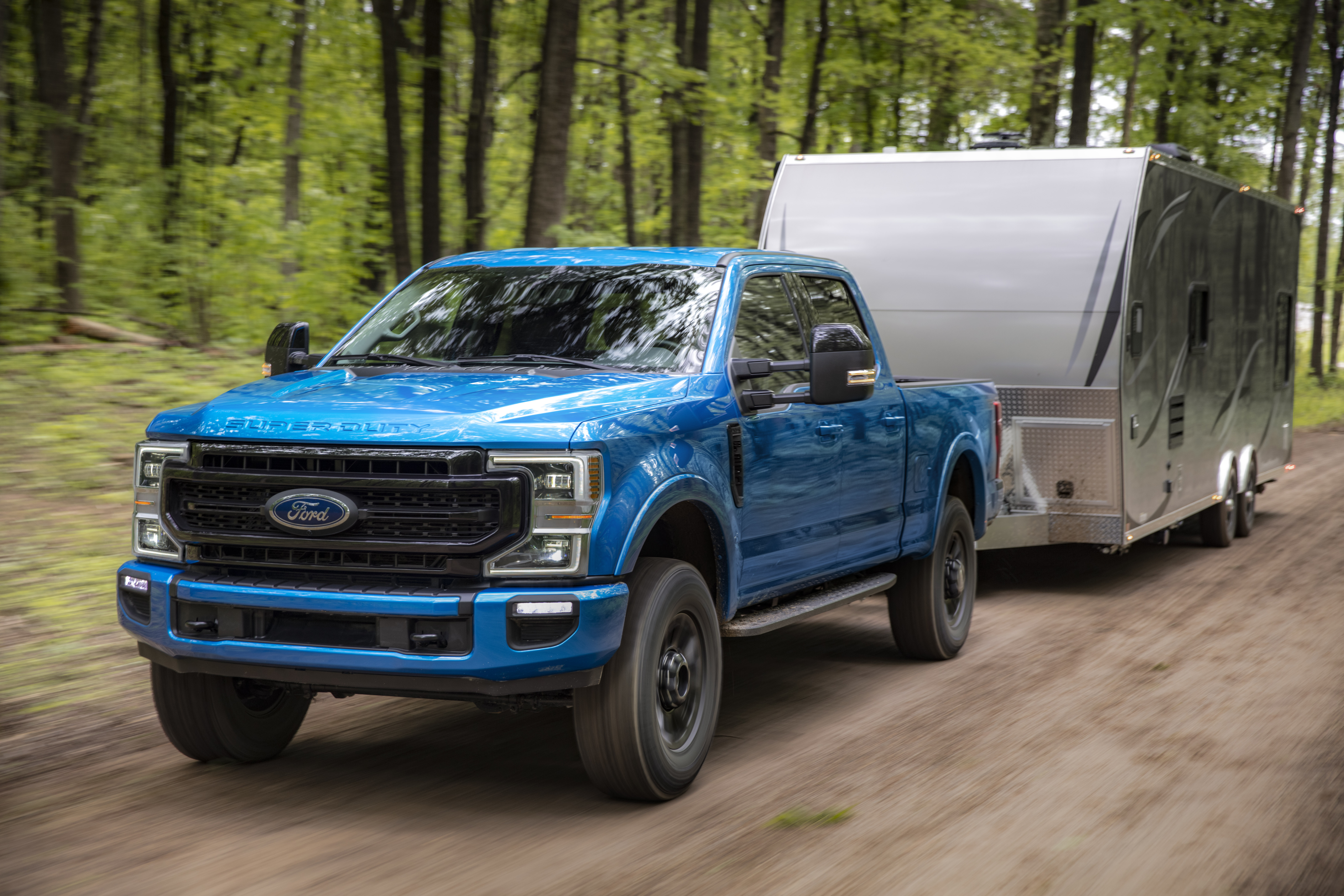 F-Series Super duty towing trailer through woods