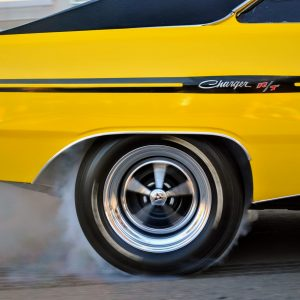 Rear Tire of Yellow Dodge Charger Doing a burnout
