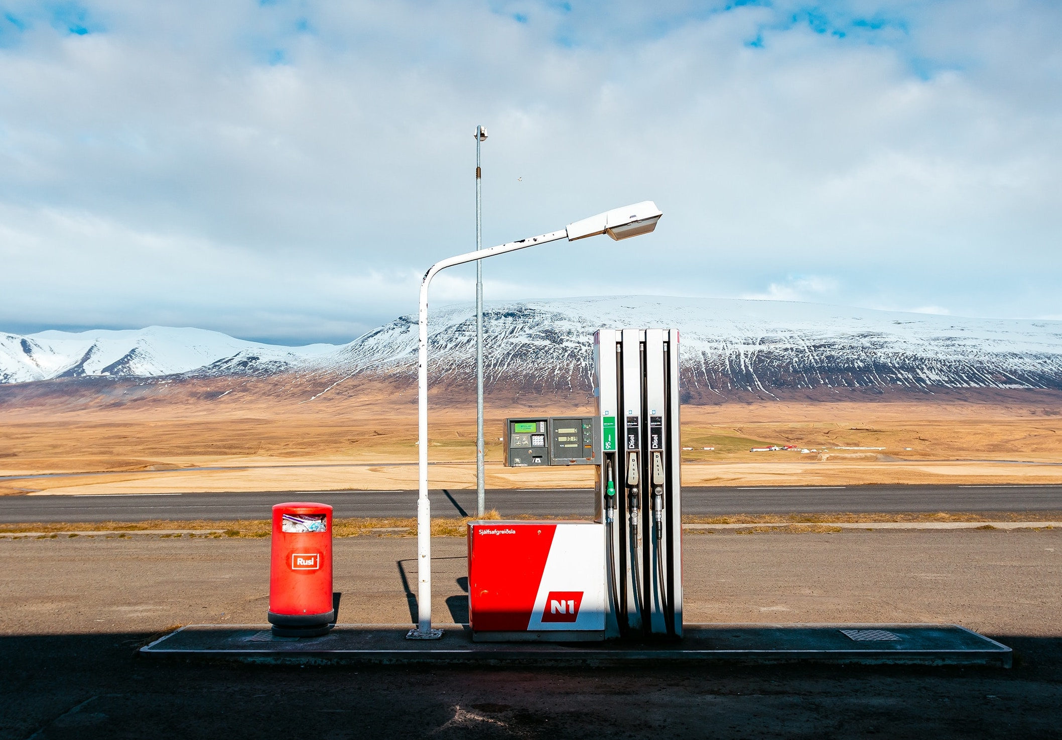 A gas pump by mountains