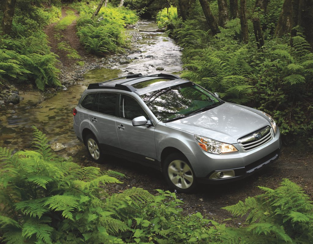 Used Subaru Outback Offroading in forest