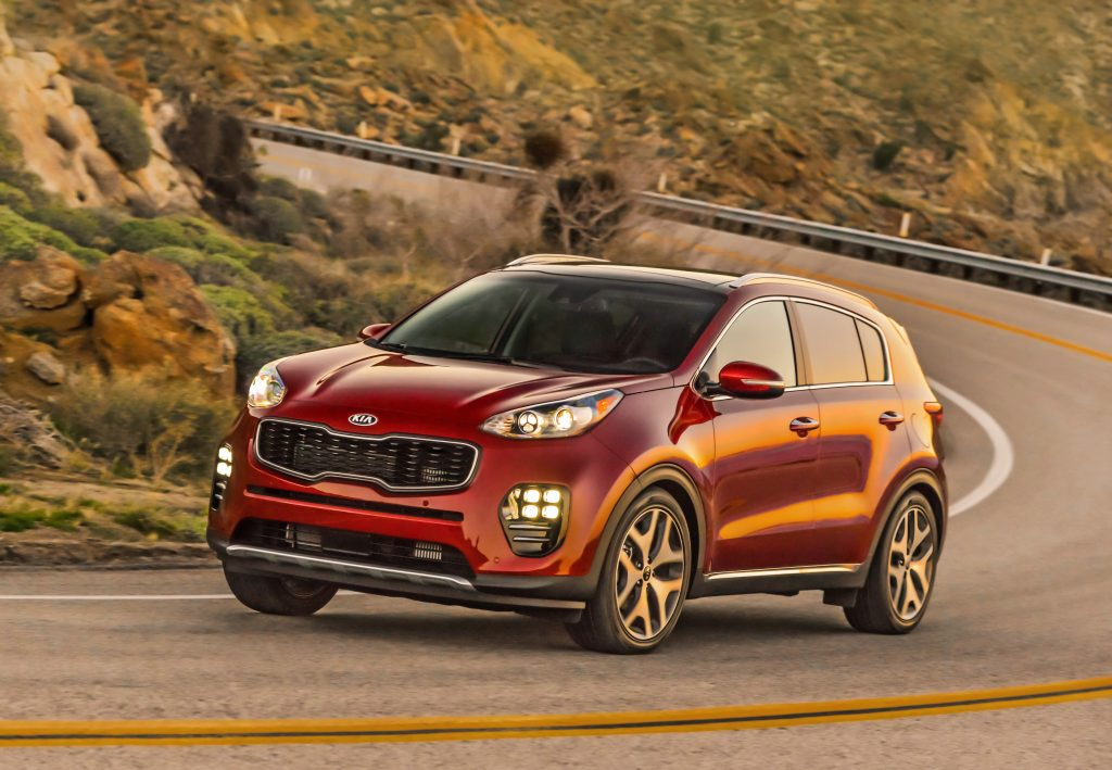 Red 2019 Sportage on Hilly road