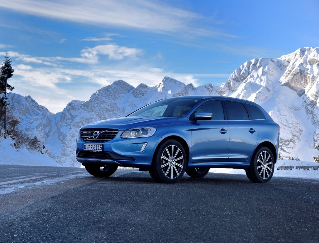 Blue Volvo XC60 in the mountains