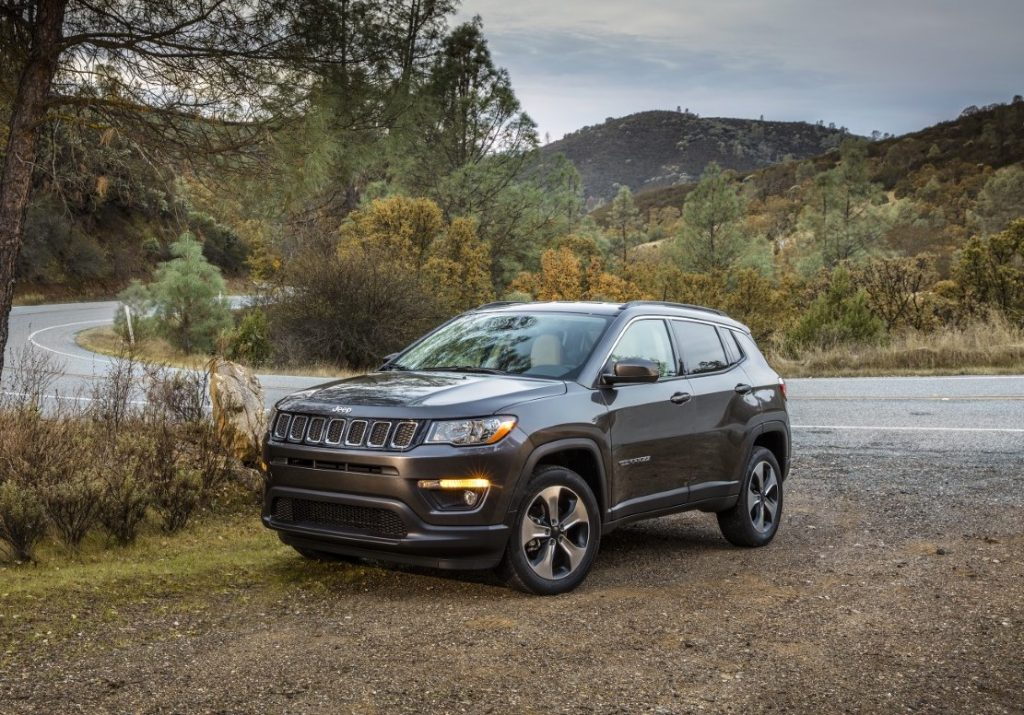Used Jeep Compass by mountain road
